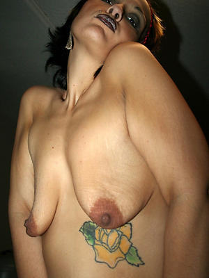 nasty mature tattooed women sex pics