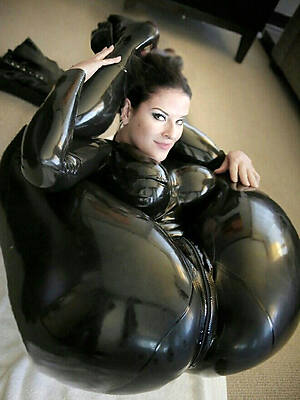 sexy full-grown latex displaying her pussy