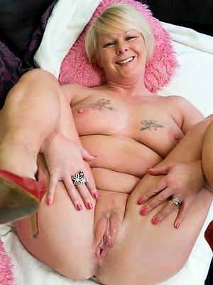 tattooed mature stripped