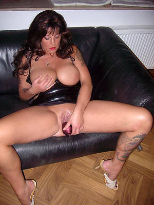 free mature women with tattoos posing stripped