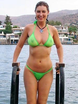 mature bikini babe in arms titties