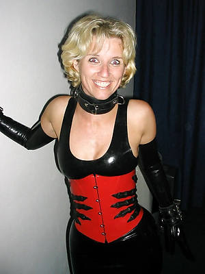 low-spirited women in latex stripped