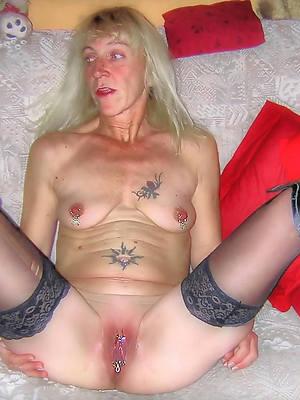 nude tattoed body of men stripped