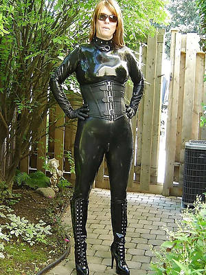 mature latex having sex pic