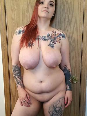 beautiful tattooed mature body of men photo