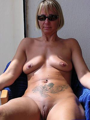 really tattooed mature women nude pics